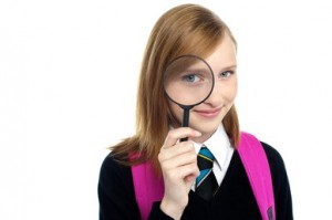 student.looking through magnifying glass